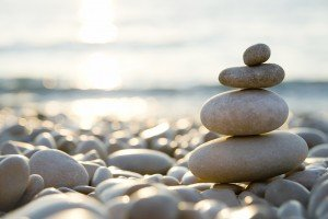 Balanced-stones-on-a-pebble-beach-during-sunset-000006631415_Large